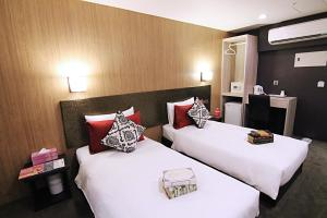 A bed or beds in a room at Ecfa Hotel - Wannin