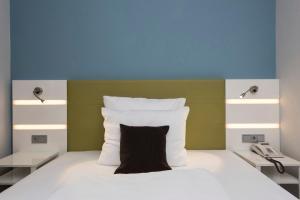 Ein Bett oder Betten in einem Zimmer der Unterkunft Best Western Hotel Dortmund Airport