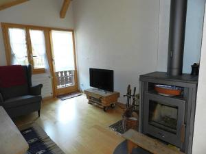 A television and/or entertainment center at Apartment Im Wiesengrund