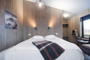 A bed or beds in a room at Arnarstapi Cottages