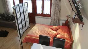Łóżko lub łóżka w pokoju w obiekcie Willa Dewajtis