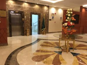 O saguão ou recepção de Abat Suites
