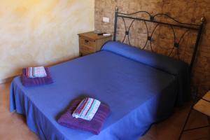Cama o camas de una habitación en Pensión Media Luna