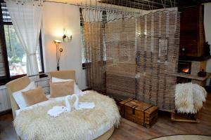 A bed or beds in a room at Momini Dvori Boutique Guest House