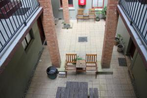 A porch or other outdoor area at Alpine Heritage Motel