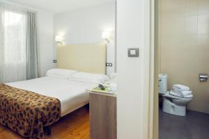 A bed or beds in a room at Casual Gurea