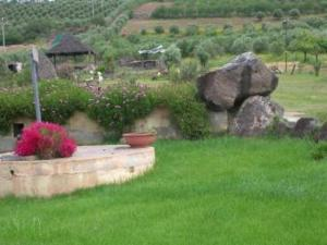 A garden outside Hotel Su Nuraxi