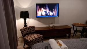 A television and/or entertainment center at Maxhouse Reykjavik
