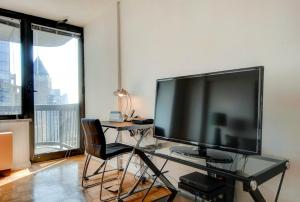 A television and/or entertainment center at Bluebird Suites in Midtown West