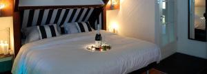 Een bed of bedden in een kamer bij Geinig