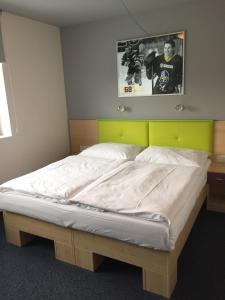 Кровать или кровати в номере Sport hotel Sletiště
