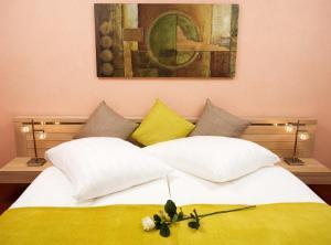 Postel nebo postele na pokoji v ubytování Hotel Relax