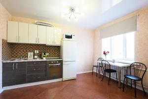 Кухня или мини-кухня в Apartment Viphome on Sovetskaya, 69
