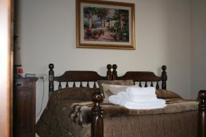Letto o letti in una camera di Relais Il Monticello