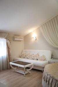 Кровать или кровати в номере Черная Жемчужина