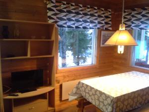 A television and/or entertainment center at Vipati Cottage