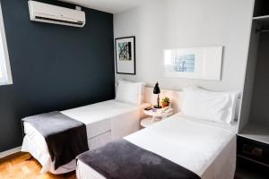 Cama ou camas em um quarto em Bê Hotel