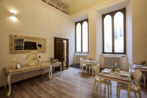 A restaurant or other place to eat at Palazzo del Magnifico B&B