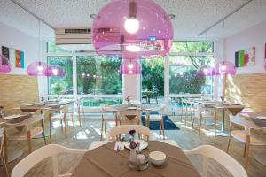 A restaurant or other place to eat at fab Hotel