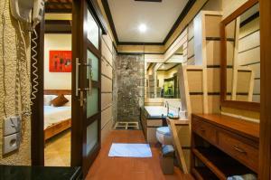A bunk bed or bunk beds in a room at Taman Sari Bali Villas Kerobokan
