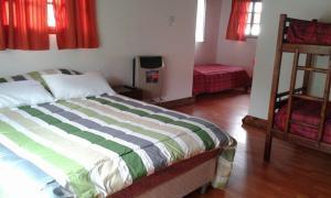 Una cama o camas en una habitación de La Protegida