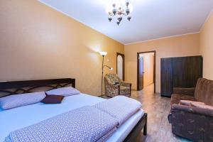 Кровать или кровати в номере U-Apart Mayaka