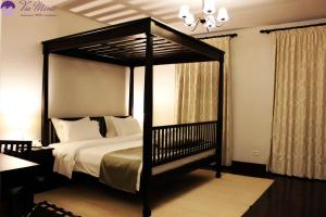 A bed or beds in a room at Via Mina Hotel