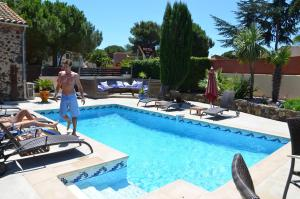 The swimming pool at or near La Bergerie Du Cap