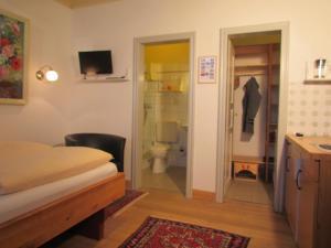 Ein Bett oder Betten in einem Zimmer der Unterkunft Apartements im Froschhaus