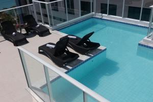 The swimming pool at or close to Slim Pajuçara by Tropicalis