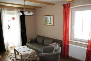 Ein Sitzbereich in der Unterkunft Ferienhaus Niedan