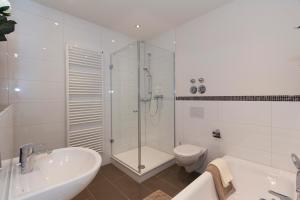 Ein Badezimmer in der Unterkunft Gästehaus am Lindenhain