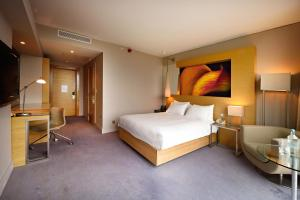 A bed or beds in a room at Hilton Manchester Deansgate