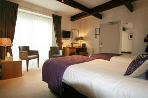 A bed or beds in a room at Quayside Hotel