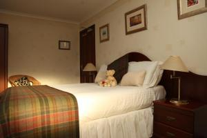 A bed or beds in a room at Gowanlea Guest House