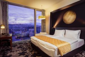 A bed or beds in a room at Kameha Grand Bonn