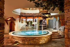 The swimming pool at or near Relais&Châteaux Spa-Hotel Jagdhof