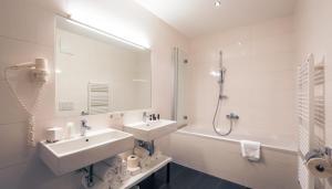 Ein Badezimmer in der Unterkunft Residence Bellevue by Alpin Rentals