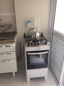 A cozinha ou cozinha compacta de BE Morumbi