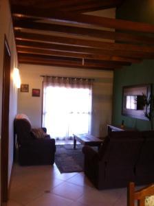 Uma área de estar em Apartamento Altreider