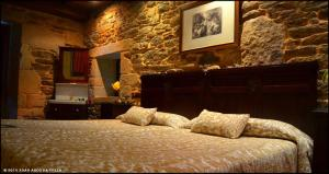 A bed or beds in a room at Pazo de Bendoiro