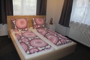 A bed or beds in a room at Bismarck Hostel Öhringen