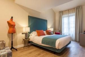 Een bed of bedden in een kamer bij Hotel Palacete de Alamos