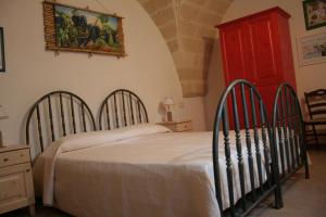A bed or beds in a room at B&B Meridiana