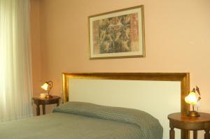 Letto o letti in una camera di Hotel Alpino