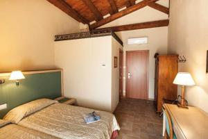 A bed or beds in a room at Hotel Residence Diamantina