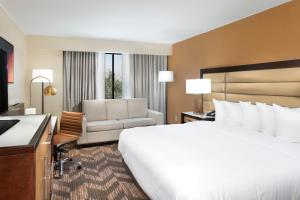 A bed or beds in a room at DoubleTree by Hilton Lawrence