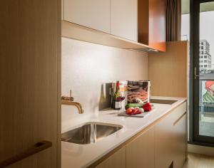 A kitchen or kitchenette at Brady Hotels Central Melbourne