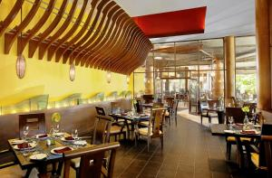 A restaurant or other place to eat at Rawi Warin Resort And Spa - SHA Plus