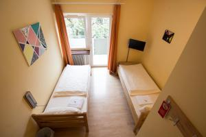 A bed or beds in a room at Hostel SLEPS